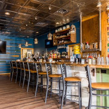 Enjoy this conceptual dining experience at Fins Ale and Raw Bar with a focus on fresh fish, choice raw oysters, and local craft beer.
